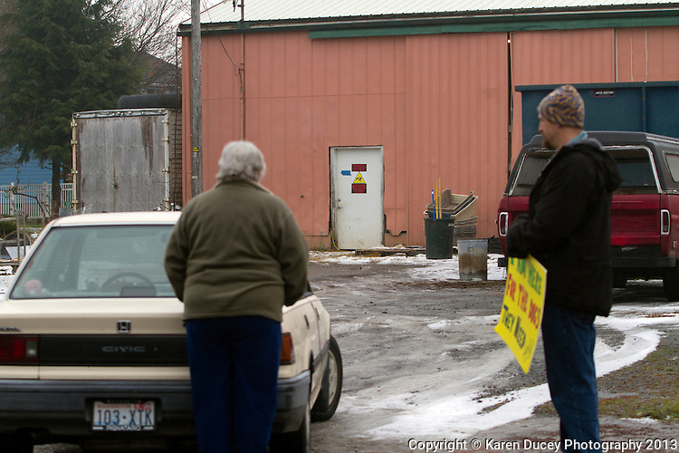 "Robert Pregulman, founder of the website Seattle Dog Spot, protests in front of the Olympic Animal Sanctuary with another protester in Forks, WA on December 10, 2013.  ""I was out here 4.5 hours yesterday and not one dog was taken outside.""<br /> <br /> <br /> ""The barking is sometimes, you don't hear it.  But once one dog barks they all go off.  I timed it yesterday.  It was about 3 hours of almost nonstop barking.  Which, if there was people in there you would say its an insane asylum. If people were yelling and screaming for that long.  These dogs are in cages and crates and they sit there all day.  Its awful. ""<br /> <br /> ""It makes me sick.   I went home last night and I was horribly depressed because its just awful to listen to these poor dogs in there.  There's a dog in that window that jumps up and howls.  I guess he's locked in a room, I don't know.  For anybody with an ounce of humanity how can you just sit here and listen to it and not be affected.  I just don't understand.""<br /> <br /> ""It just is incredibly disturbing and you think about your own dogs and I just don't understand why this place is still allowed to be open because it just makes no sense to me.""<br /> <br />  Owner Steve Markwell Markwell has been under fire for neglecting the dogs after volunteers filed a complaint in 2012. The City of Forks police department investigated and found horrific conditions but said legally they were unable to do anything about it. Markwell claims he has 125 dogs inside and believes he is their last hope.  Many of the dogs were turned over to him by rescues and shelters who deemed them dangerous. Mounting evidence of animal cruelty has prompted many of them to ask for their dogs back.  Markwell refuses and only lets a few trusted volunteers enter the premises."