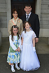 Katie Branigan pictured after making her First Communion at the Lourdes Church on Saturday with her parents John and Shirley and sister Anna. www.newsfile.ie