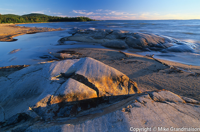 Lake Superior and rocks at sunset<br /> Neys Provincial Park<br /> Ontario<br /> Canada