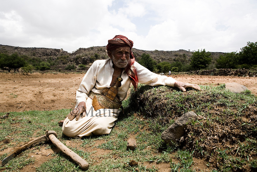 Yemen - 100 years old farmer remembers how fertile was this river bed where he is standing, until 30 years ago when it was fully covered with any kind of plant and is now almost dry with only a few plants left. Yemen's economy depends heavily on oil production, and its government receives the vast majority of its revenue from oil taxes. Yet analysts predict that the country's petroleum output, which has declined over the last seven years, will fall to zero by 2017. The government has done little to plan for its post-oil future. Yemen's population, already the poorest on the Arabian peninsula and with an unemployment rate of 35%, is expected to double by 2035..The trends will exacerbate large and growing environmental problems, including the exhaustion of Yemen's groundwater resources. Given that a full 90% of the country's water is used for agriculture, this trend portends disaster..Sanaa's well are expected to dry out by 2015, partly due to illegal drilling, partly because 40% of the city's water is diverted for qat production, and partly because conservation rules are difficult to enforce. Only 20% of the houses receive water, the other 80% has to collect it from pumps and wells. 15% of the urban population only uses bottled water as its primary drinking water source and that is why Yemen has one of the highest world mortality rate, most of the diseases being related to water..
