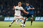 Keisuke Honda of AC Milan being followed by Pedro Miguel Gomes Delgado  of FC Internazionale Milano during the AC Milan vs FC Internazionale Milano as part of the International Champions Cup 2015 at the Longgang Stadium on 25 July 2015 in Shenzhen, China. Photo by Hendrik Frank / Power Sport Images