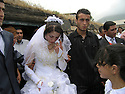 Armenia 2007 <br /> A Yezidi wedding in a village: the bride leaving her village <br /> Armenie 2007 <br /> Un mariage yezidi , la mari&eacute;e quitte son village accompagn&eacute;e d'un homme de sa famille