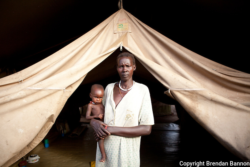 Nyachuol  and her child outside of the Therapeutic feeding center at MSF's hospital in Nasir, South Sudan.