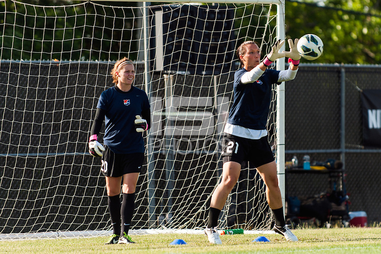 Sky Blue FC goalkeeper Jill Loyden (21) warms up as goalkeeper Ashley Baker (20) looks on prior to playing the Western New York Flash during a National Women's Soccer League (NWSL) match at Yurcak Field in Piscataway, NJ, on June 8, 2013.