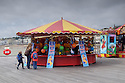 "A fairground stall on Hastings Pier offers children the opportunity to ""Hook a Duck"". The pier has recently (April 2016) been reopened after extensive rebuilding owing to a fire razing it to the ground in 2010. The council compulsorily purchased it from its owners in 2012, and the so-called ""people's pier"" is now in the hands of the Hastings Pier Charity and more than 3,000 shareholders, who bought into the project at £100 a share."