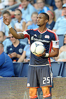 Darrius Barnes (25) defender  New England Revolution about to take a throw in..Sporting Kansas City and New England Revolution played to a 0-0 tie at LIVESTRONG Sporting Park, Kansas City, KS.