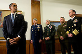 Arlington, VA - January 28, 2009 -- President of the United States Barack Obama, flanked by Gen. Norton Schwartz, U.S. Air Force chief of staff; Gen. George W. Casey, U.S. Army chief of staff; U.S. Marine Gen. James E. Cartwright, vice chairman of the Joint Chiefs of Staff and U.S. Navy Adm. Mike Mullen, chairman of the joint chiefs of staff, addresses the media during his first visit to the Pentagon since becoming commander-in-chief, Jan. 28, 2009. Obama and Vice President Joe Biden met with Secretary of Defense Robert M. Gates and all the service chiefs getting their inputs on the way ahead in Afghanistan and Iraq. .Credit: Chad J. McNeeley - DoD via CNP