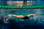 Ohio University junior Deidre Geroni pushes off from a flip turn during the 400-yard freestyle relay in a meet against Ball State University Jan.1 at the Ohio University Aquatic Center. Ohio won the meet 189-106.