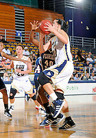 Florida International University guard Fanni Hutlassa (10) plays against Florida Atlantic University which won the game 50-49 on January 21, 2012 at Miami, Florida. .