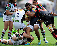 Billy Vunipola of Saracens fights to hang onto the ball as a maul forms during the Aviva Premiership semi final match between Saracens and Harlequins at Allianz Park on Saturday 17th May 2014 (Photo by Rob Munro)