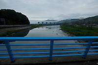 A landscape view of a bridge and river dam in Miyako Bay during reconstruction efforts following the 311 Tohoku Tsunami in Miyako, Japan  © LAN