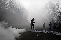 Skouries, Greece Sunday 23 November 2014<br /> Pictured: A protester with a gas mask attempts to avoid the tear gas<br /> Re: Riot police called to break up a protest by local residents against a Canadian-run goldmine in Skouries, in the Chalkidiki area. Eldorado firm has been accused of dumping toxic waste generated during gold processing in northern Greece, into local rivers. Teargas was used by the police to disperse the protesters who retaliated with pyrotechnics.