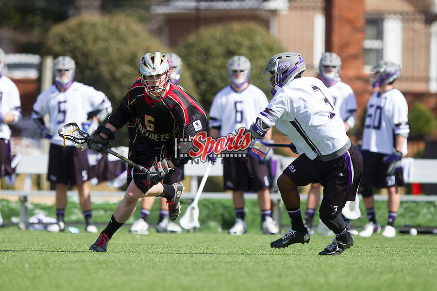 Brad Nardella (6) of the VMI Keydets keeps the ball away from Richard Byrd (3) at Vert Track, Soccer & Lacrosse Stadium on March 8, 2014 in High Point, North Carolina.  The Panthers defeated the Keydets 9-8.   (Brian Westerholt/Sports On Film)