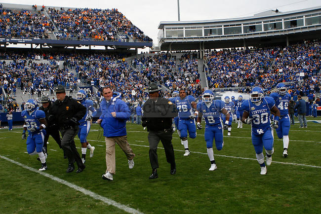 UK head football coach Rich Brooks runs on the field at the start of UK's game against Tennessee on Nov. 24, 2007 at Commonwealth Stadium. Photo by Britney McIntosh | Staff