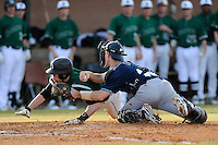Catcher Ryan Kilgallen (13) of the Citadel makes the tag as A.J. Mackey (13) of USC Upstate tries to score on a double in the bottom of the second inning in a game on Tuesday, February, 18, 2014, at Cleveland S. Harley Park in Spartanburg, South Carolina. Upstate won, 6-2. (Tom Priddy/Four Seam Images)