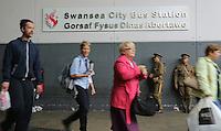 Men in World War I gear outside the Bus Station in Swansea, south Wales UK. Friday 01 July 2016