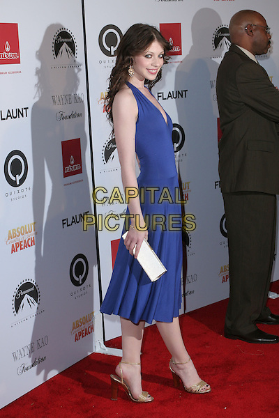 MICHELLE TRACHTENBERG.Flaunt Magazine 7th Annual Anniversary Party and Holiday Toy Drive held at a Private Residence, Los Angeles, California.  .December 2nd, 2005.Photo: Zach Lipp/AdMedia/Capital Pictures.Ref: ZL/ADM.full length purple blue halterneck dress clutch purse.www.capitalpictures.com.sales@capitalpictures.com.© Capital Pictures.