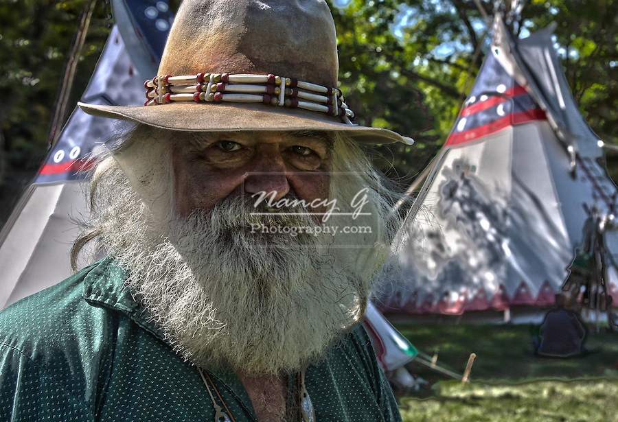 An HDR image of amountainman in a Native American Indian camp