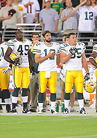 Aug. 28, 2009; Glendale, AZ, USA; Green Bay Packers linebacker (49) Cyril Obiozor , quarterback (12) Aaron Rodgers and fullback (35) Korey Hall prior to the game against the Arizona Cardinals during a preseason game at University of Phoenix Stadium. Mandatory Credit: Mark J. Rebilas-