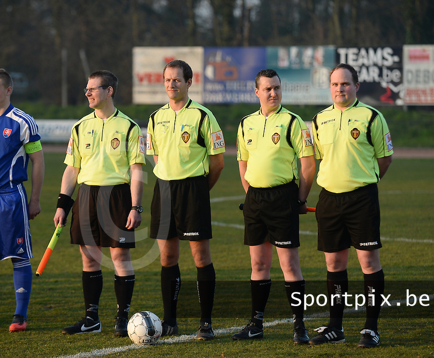 20140312 - MEULEBEKE , BELGIUM : referees pictured during a friendly soccer match between the Under16 soccerteams of Belgium and Slovakia , Wednesday 12 March 2014 in Meulebeke . PHOTO DAVID CATRY