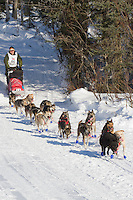 Musher Paul Johnson on Long Lake at the Re-Start of the 2011 Iditarod Sled Dog Race in Willow, Alaska.