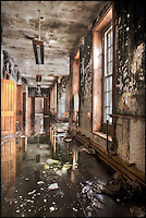 Flooded asylum corridor with windows and doors