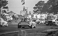 #49 Chevrolet Monza of Paul Romano, Peter Kirill, and Hoyt Overbagh (45th place) spins in traffic, 12 Hours or Sebring, Sebring International Raceway, Sebring, FL, March 19, 1983.  (Photo by Brian Cleary/bcpix.com)