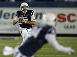 Nevada quarterback Cody Fajardo (17) looks downfield at receiver Jerico Richardson (84) during the first half of an NCAA college football game in Reno, Nev., on Saturday, Oct. 4, 2014. Boise State won 51-46. (AP Photo/Cathleen Allison)