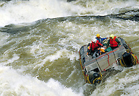 Expedition raft running a class 5 rapid on the Ruppert River. Mistassanni Quebec Canada Ruppert River.