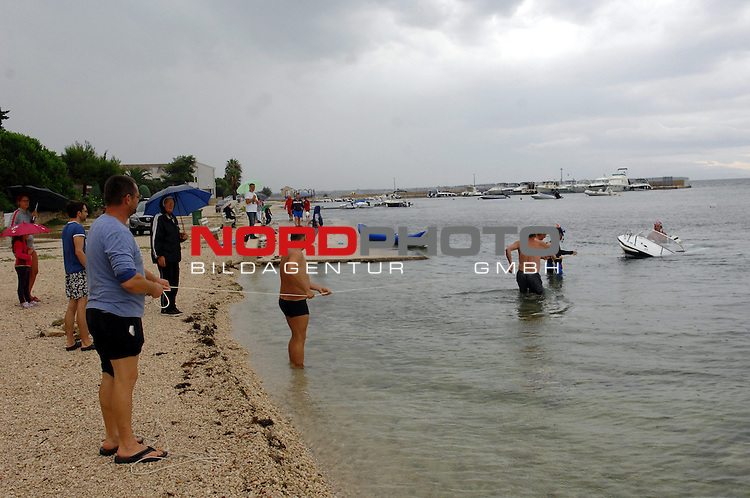 30.07.2014., Island Vir, Croatia - Island Vir was hit by a severe thunderstorm. Backyards, gardens, city streets and basements are flooded and a few boats are sunken.<br /> Foto &copy; nph / Damir Spehar/PIXSELL