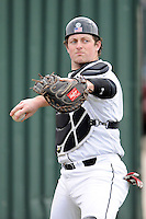 Catcher Taylor Hunter (38) of the South Carolina Gamecocks prior to the Reedy River Rivalry game against the Clemson Tigers on Saturday, February 28, 2015, at Fluor Field at the West End in Greenville, South Carolina. South Carolina won, 4-1. (Tom Priddy/Four Seam Images)