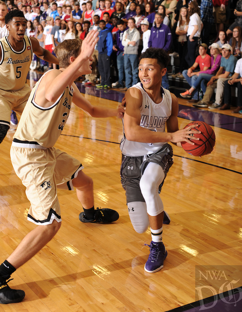NWA Democrat-Gazette/ANDY SHUPE<br /> Payton Willis (right) of Fayetteville drives to the lane as Arman Akbar (left) of Bentonville defends Friday, Jan. 29, 2016, during the first half of play at Bulldog Arena in Fayetteville. Visit nwadg.com/photos to see more photographs from the game.