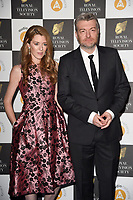 LONDON, UK. March 19, 2019: Annabel Jones & Charlie Brooker arriving for the Royal Television Society Awards 2019 at the Grosvenor House Hotel, London.<br /> Picture: Steve Vas/Featureflash