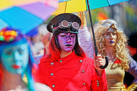 Pictured: A young woman takes part in the Pride parade as it travels through the streets of Swansea, Wales, UK. Saturday 05 May 2018<br /> Re: Spring Pride has brought a celebration of colour to the streets of Swansea in Wales, UK.<br /> Rainbow flags were flown in support of the LGBT community at the event, which is designed to raise awareness and is open to anyone to take part in.