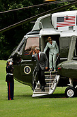 United States President George W. Bush and first lady Laura Bush arrive via Marine One on the south lawn of the White House in Washington, DC after a weekend spent relaxing at Camp David in Maryland on June 19, 2005.<br /> Credit: Jay L. Clendenin / Pool via CNP
