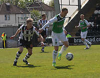 Leigh Griffiths being closed down by Marc McAusland in the St Mirren v Hibernian Clydesdale Bank Scottish Premier League match played at St Mirren Park, Paisley on 29.4.12.