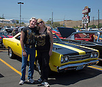 Rick Hennig and Nicole Chase stand in front of his 1969 Plymouth Roadrunner during the Hot August Nights Pre-Kickoff show and shine held at the Bonanza Casino in Reno, Nevada on Sunday, August 4, 2013.