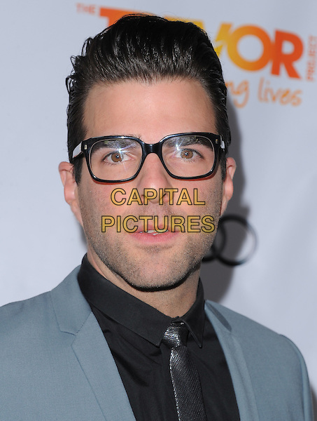 Zachary Quinto.Trevor Live at The Hollywood Palladium in Hollywood, California, USA..December 4th, 2011  .headshot portrait stubble facial hair grey gray blue suit glasses black shirt silver tie .CAP/RKE/DVS.©DVS/RockinExposures/Capital Pictures.