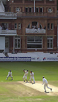 Photo Peter Spurrier.01/09/2002.Village Cricket Final - Lords.Elvaston C.C. vs Shipton-Under-Wychwood C.C..Shipton batting, Phil Garner on strike, as the the Shipton balcony watches on.