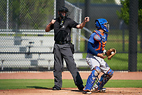 Umpire Chad Westlake calls a strikeout during a Gulf Coast League game between the GCL Mets and GCL Astros on August 10, 2019 at FITTEAM Ballpark of the Palm Beaches Training Complex in Palm Beach, Florida.  GCL Astros defeated the GCL Mets 8-6.  (Mike Janes/Four Seam Images)