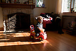 Her son Sean plays on a toy fire truck in the living room..A day in the life of Rosaleen Tallon, sister of firefighter Sean Tallon killed in the 9/11 World Trade Center attacks. In response to the proposed WTC memorial being built underground at the site, Ms. Tallon has been sleeping for 16 days in front of the fire house across from the WTC site. She and several other WTC families are protesting the memorial design and asking for the victim's names to be placed above ground for the sake of honoring the lives lost and safety concerns with any possible future evacuation of the site.
