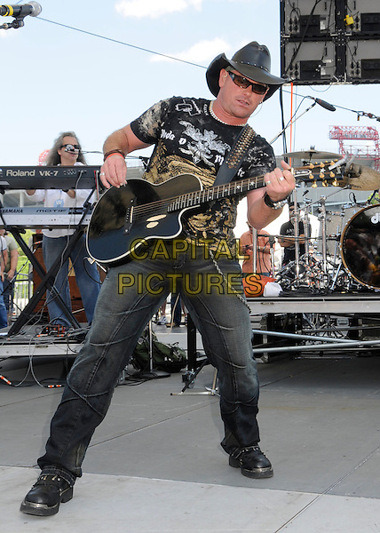 KEITH ANDERSON.2008 CMA Music Festival Greased Lightning Riverfront Daytime Stage, Nashville, Tennessee, USA, .05 June 2008..country music microphone concert gig on stage full length black cowboy hat guitar jeans.CAP/ADM/LF.©Laura Farr/Admedia/Capital PIctures