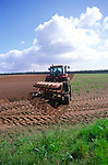 A0742P Red tractor ploughing a field in Suffolk Sandlings England
