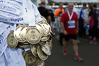 09 SEP 2011 - CHESTER, GBR - Finishers medals hang from a post ready for those runners who have completed the MBNA Chester Marathon (PHOTO (C) NIGEL FARROW)
