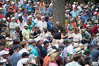 Tyrrell Hatton (ENG) lost in the crowd on 10 during the 2nd round at the The Masters, Augusta National, Augusta, Georgia, USA. 12/04/2019.<br /> Picture Fran Caffrey / Golffile.ie<br /> <br /> All photo usage must carry mandatory copyright credit (© Golffile | Fran Caffrey)