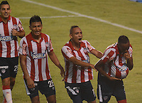 BARRANQUIILLA -COLOMBIA-03-09-2014. Luis Quiñones (Der) jugador de Atlético Junior celebra un gol anotado a Atlético Huila durante partido por la fecha 1 de la Liga Postobón II 2014 jugado en el estadio Metropolitano Roberto Meléndez de la ciudad de Barranquilla./ Luis Quiñones (R) player Atletico Junior celebrates a goal scored to Atletico Huila during match for the first date of the Postobon League II 2014 played at Metropolitano Roberto Melendez stadium in Barranquilla city.  Photo: VizzorImage/Alfonso Cervantes/STR