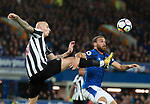 Jonjo Shelvey of Newcastle United tackles Cenk Tosun of Everton during the premier league match at Goodison Park Stadium, Liverpool. Picture date 23rd April 2018. Picture credit should read: Simon Bellis/Sportimage