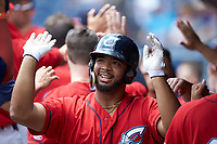 Bobby Bradley (44) of the Columbus Clippers is congratulated by his teammates after hitting a home run against the Durham Bulls at Durham Bulls Athletic Park on June 1, 2019 in Durham, North Carolina. The Bulls defeated the Clippers 11-5 in game one of a doubleheader. (Brian Westerholt/Four Seam Images)