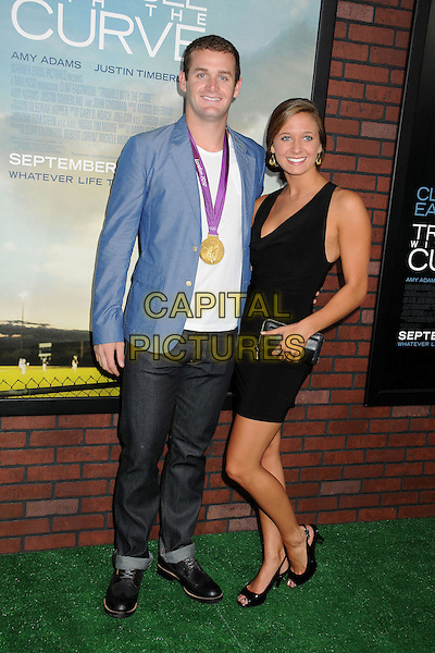 "Tyler Clary & guest.""Trouble With The Curve"" Los Angeles Premiere held at the Regency Village Theatre, Westwood, California, USA..September 19th, 2012.full length white top blue suit jacket black dress jeans denim medal award winner .CAP/ADM/BP.©Byron Purvis/AdMedia/Capital Pictures."