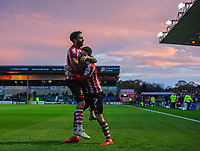 Lincoln City's Tom Pett, right, celebrates scoring his side's second goal with team-mate Bruno Andrade<br /> <br /> Photographer Chris Vaughan/CameraSport<br /> <br /> Emirates FA Cup First Round - Lincoln City v Northampton Town - Saturday 10th November 2018 - Sincil Bank - Lincoln<br />  <br /> World Copyright &copy; 2018 CameraSport. All rights reserved. 43 Linden Ave. Countesthorpe. Leicester. England. LE8 5PG - Tel: +44 (0) 116 277 4147 - admin@camerasport.com - www.camerasport.com